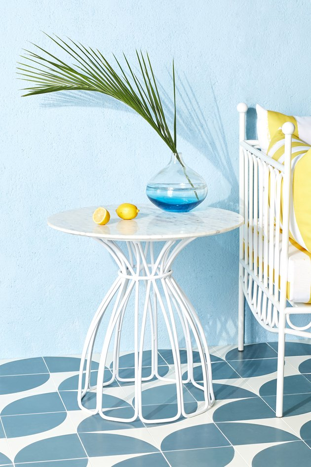 white side table with lemons and plant