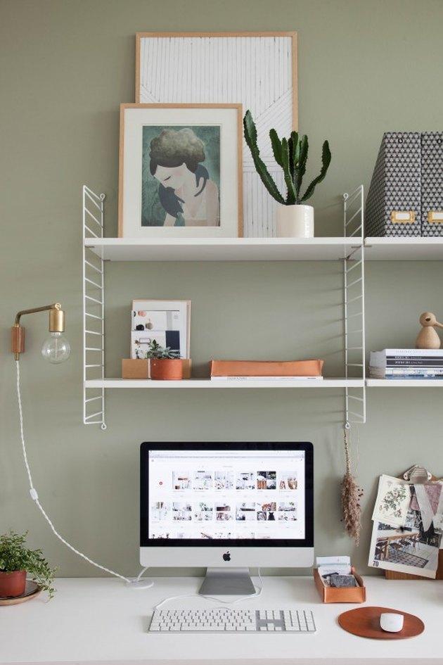 open shelving in sage green minimalist modern home office design