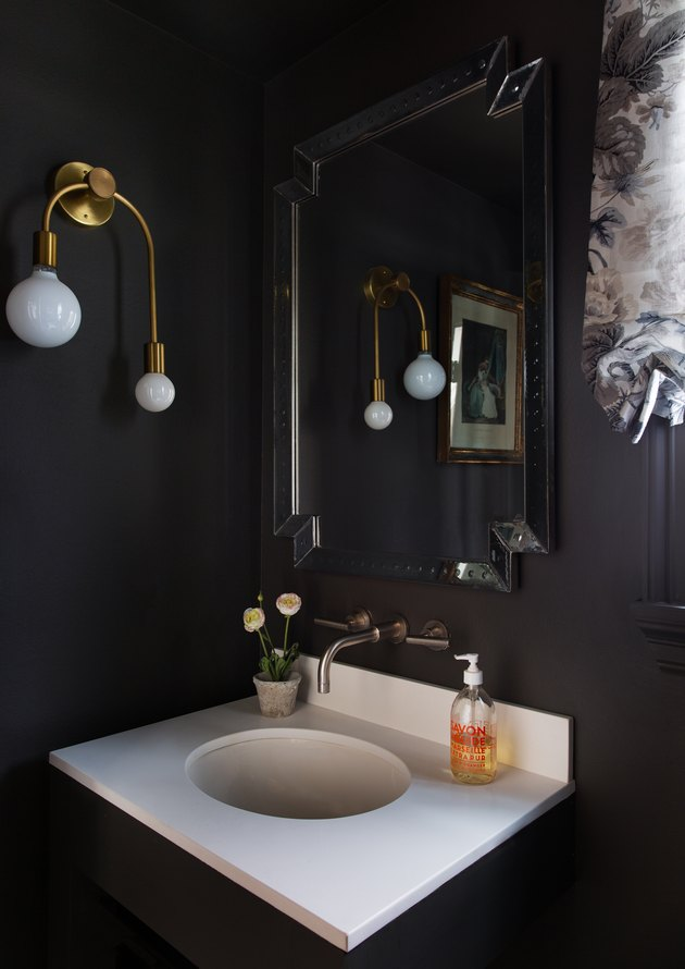 black minimalist room paint colors in bathroom with gold light fixture