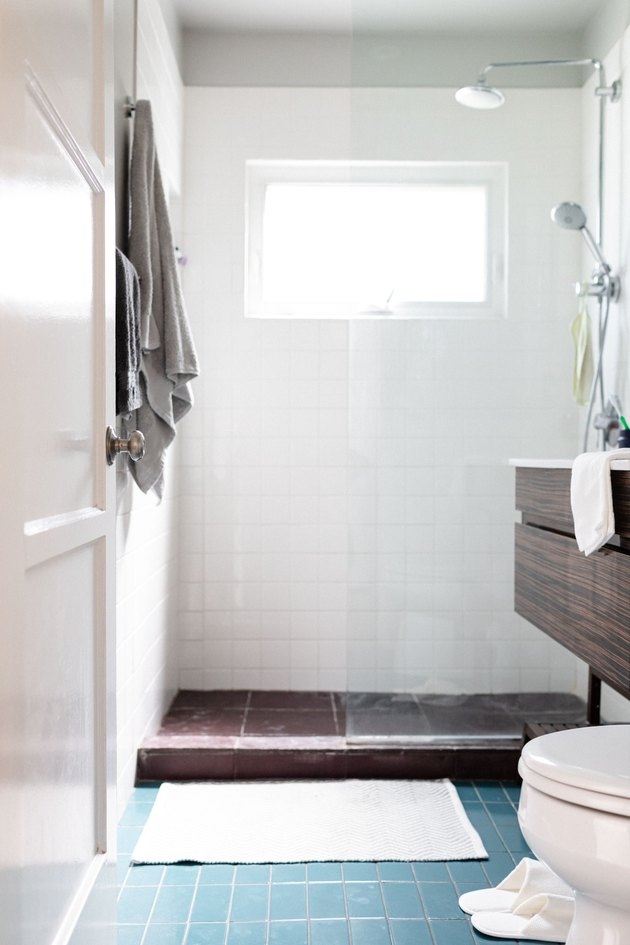 open shower; toilet and bathroom vanity in the picture