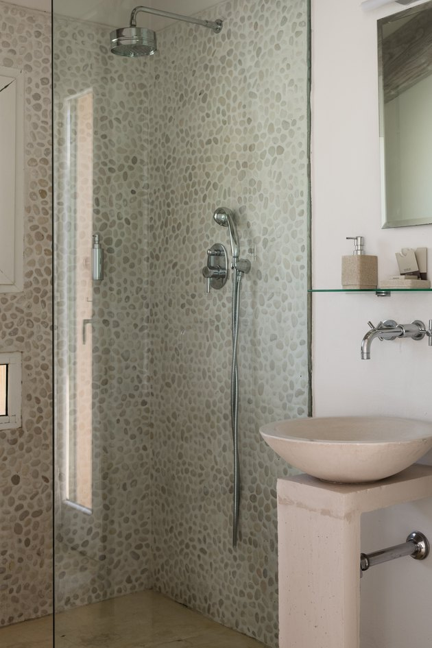 standing shower with light tile