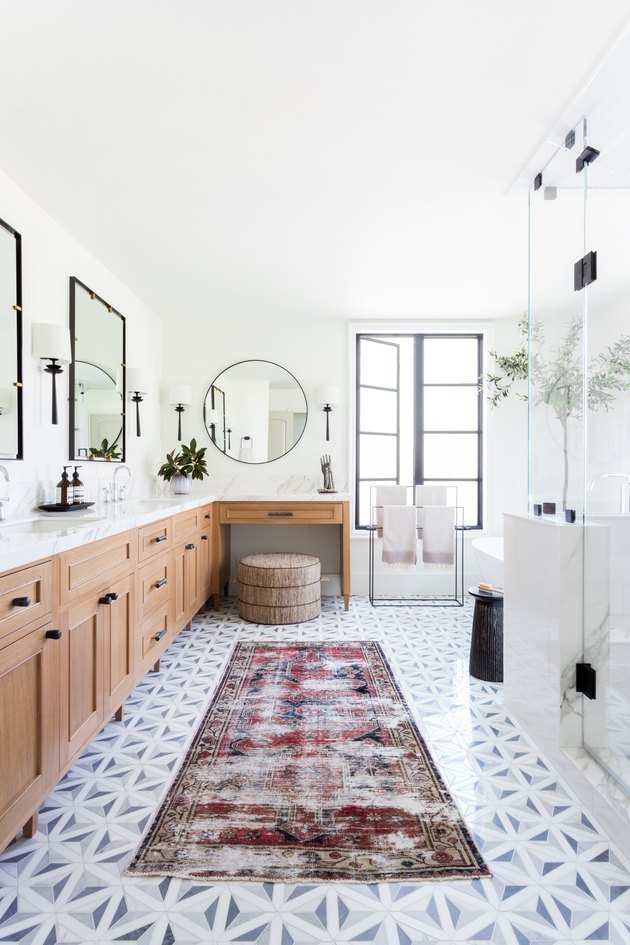 l-shaped master bathroom vanity in chic bathroom with patterned runner