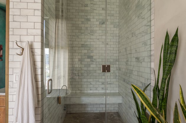 shower with light subway tile  wall and bench