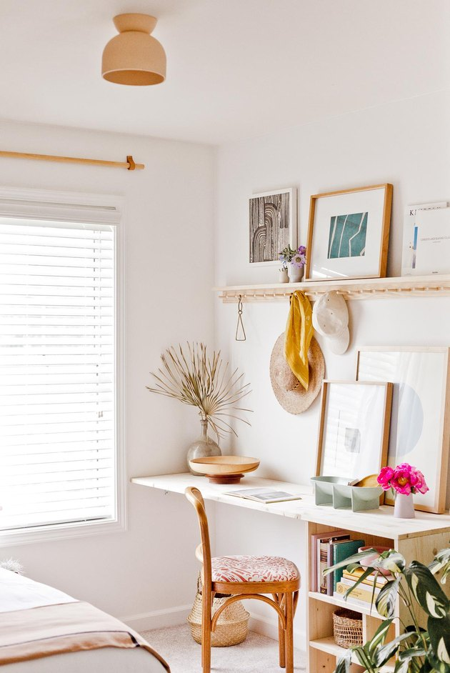 minimalist modern home office design with rattan desk chair and framed art