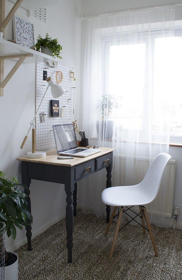 minimalist modern home office design with peg board