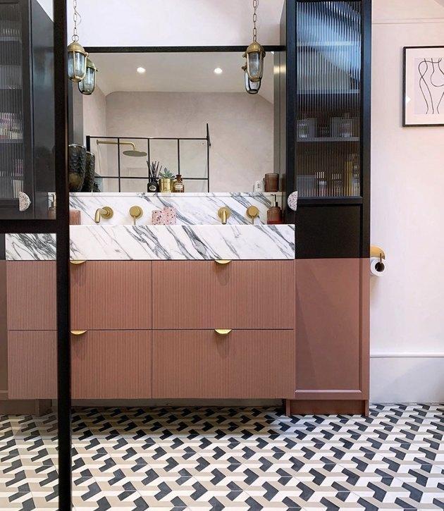 pink master bathroom vanity with marble top