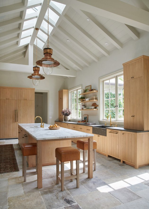 kitchen island ideas with seating in kitchen with vaulted ceiling and wood cabinets