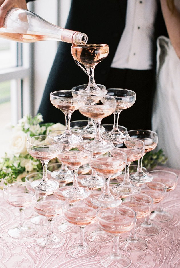 art deco themed party idea with champagne glass tower