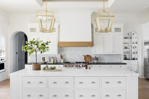kitchen island decor in white kitchen with subway tile backsplash and wood floor