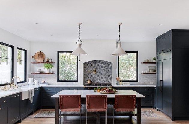 dark kitchen cabinets with light floors and tile stove backsplash