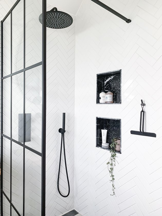 monochrome shower room with wall niches for shower storage ideas