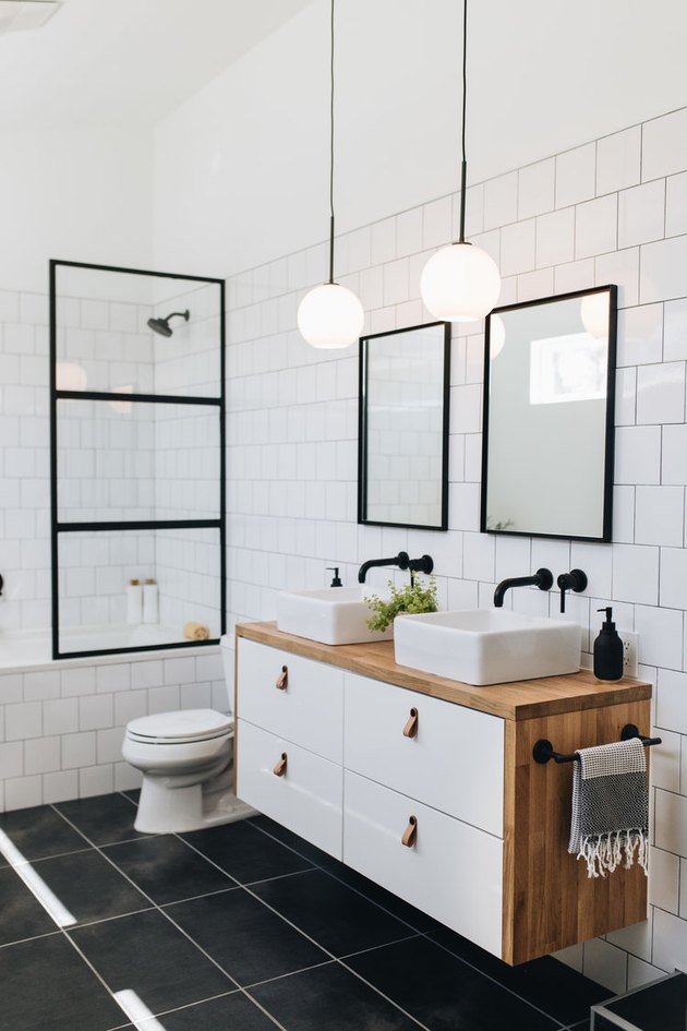 Black tile minimalist flooring in modern black and white bathroom