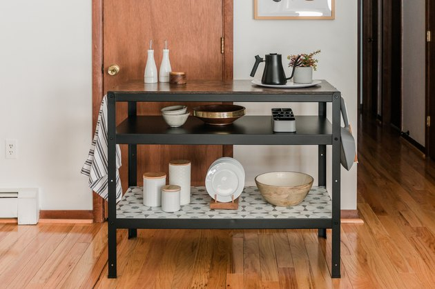 kitchen island decor on IKEA island with ceramic pottery