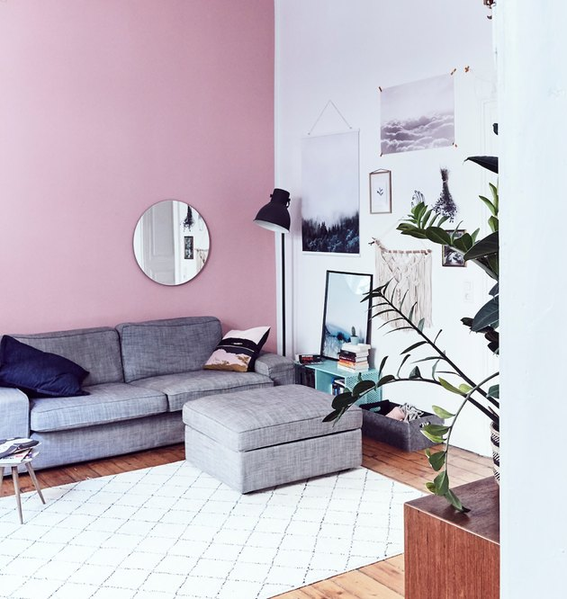 IKEA living room minimalist furniture in pink room with gray sectional