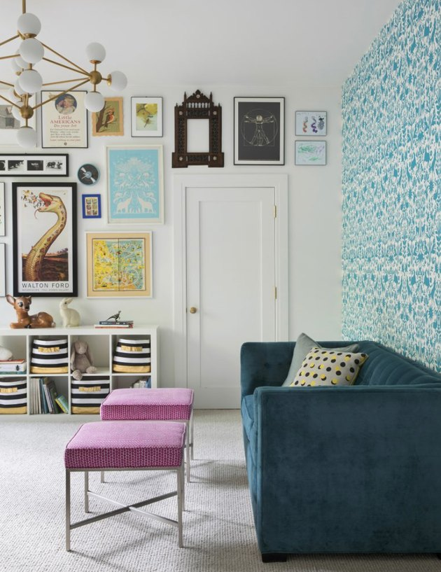 IKEA living room minimalist furniture paired with patterned blue wallpaper and blue velvet coach