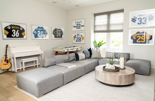 family room furniture with modular gray sectional and framed sports memoribilia