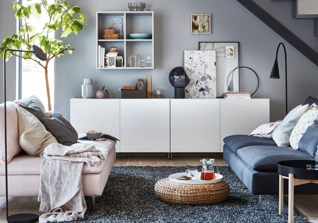 IKEA living room minimalist furniture with white credenza and rattan floor pouf