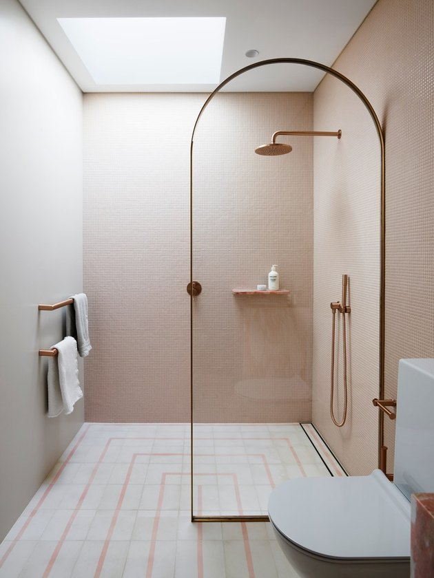 pink and white bathroom with floating shower storage ideas