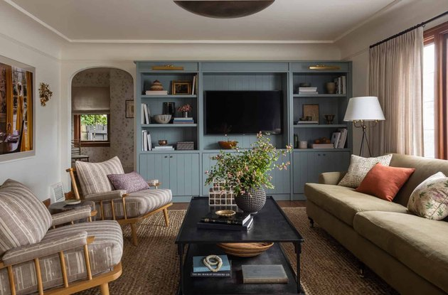 family room furniture with striped accent chairs and teal built-in shelves