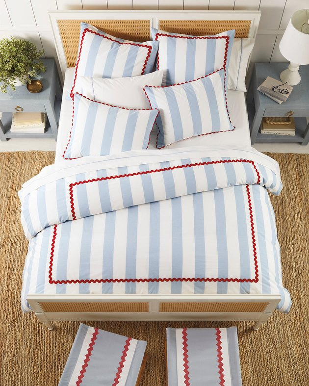 bed with blue-and-white striped bedding