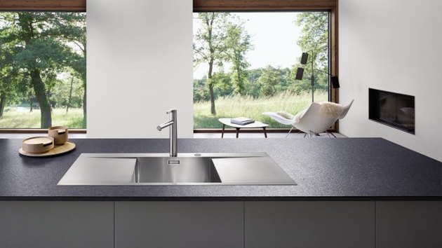 stainless steel minimalist kitchen sink with black counter