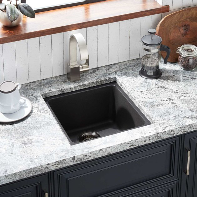 Composite granite minimalist kitchen sink with modern stainless steel faucet