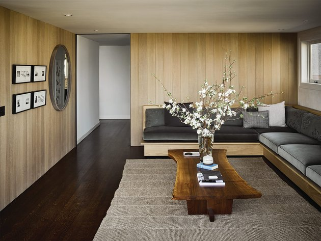 small living room idea with wood panelling on walls and built-in seating