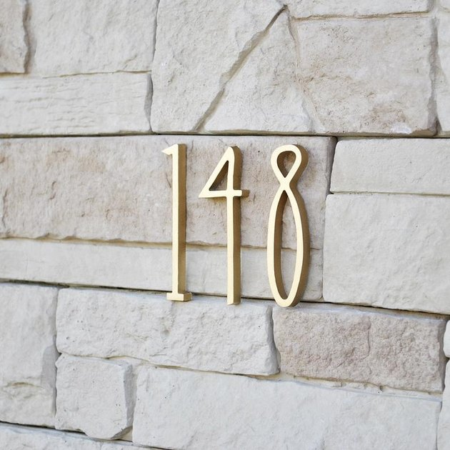art deco modern house numbers on stone siding