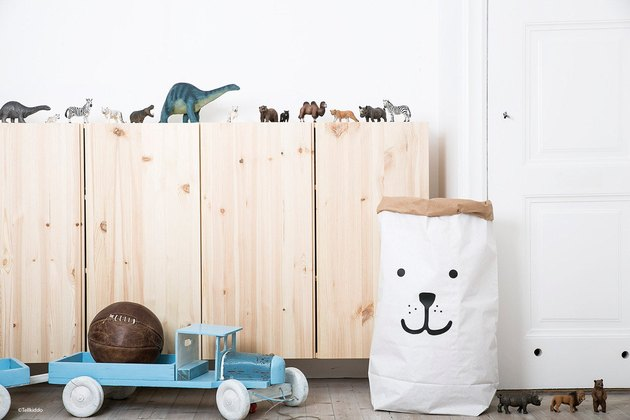 Minimalist toy storage idea in white paper bag with bear face