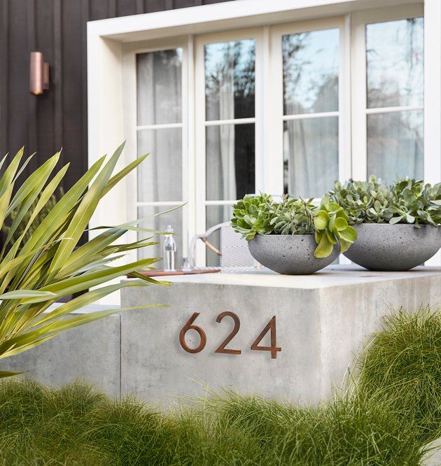 steel modern house numbers on concrete slab by Rejuvenation