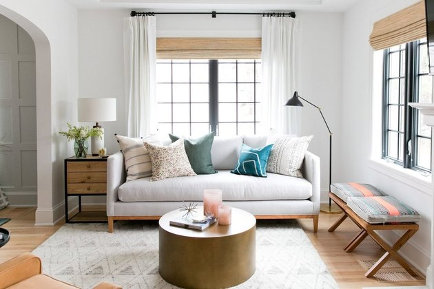 small living room idea with layered window treatments and modern floor lamp