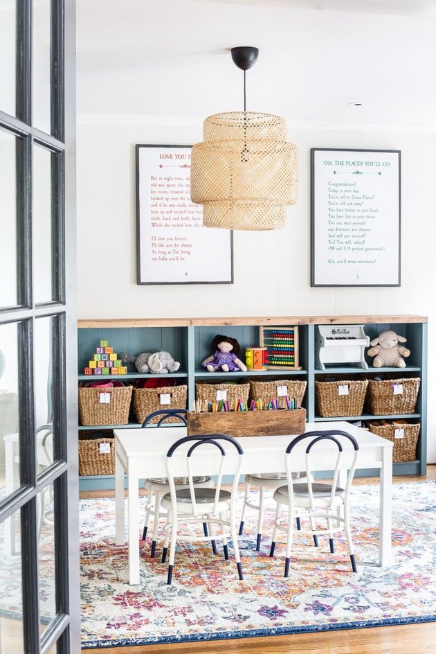 eclectic Playroom Organization Ideas with storage units, baskets and table
