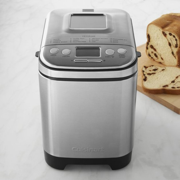 bread maker with bread nearby