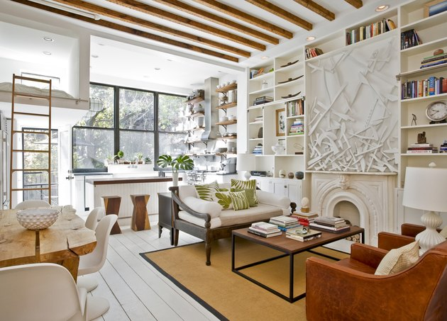 small living room idea with exposed ceiling beams and open shelving