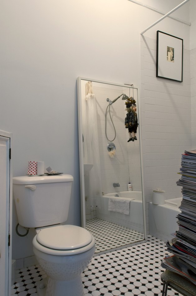 White bathroom with black and white tile floor