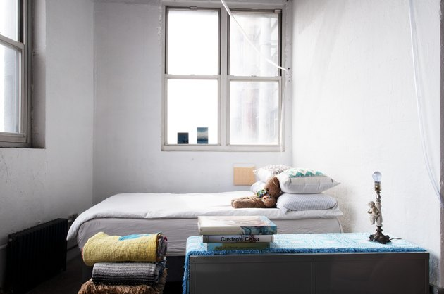 Loft with white walls and simply made bed