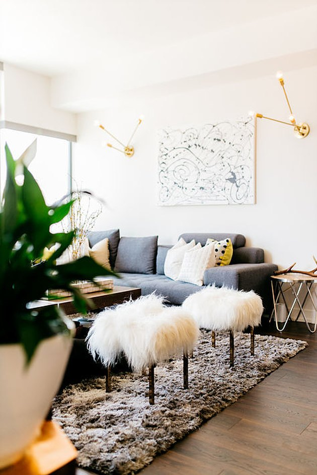 Living room lighting idea with gold sconces