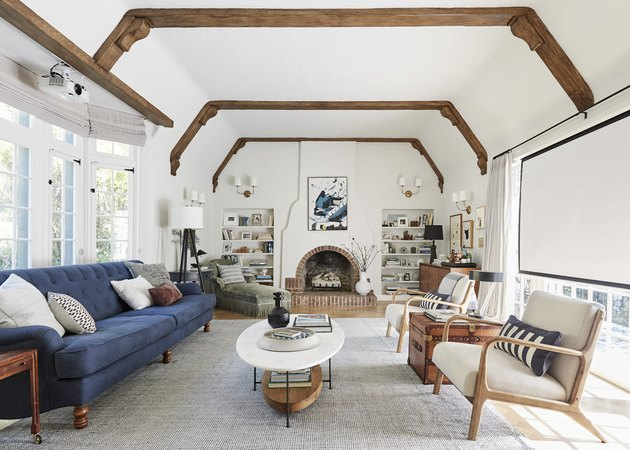 small living room idea with fireplace and exposed ceiling beams