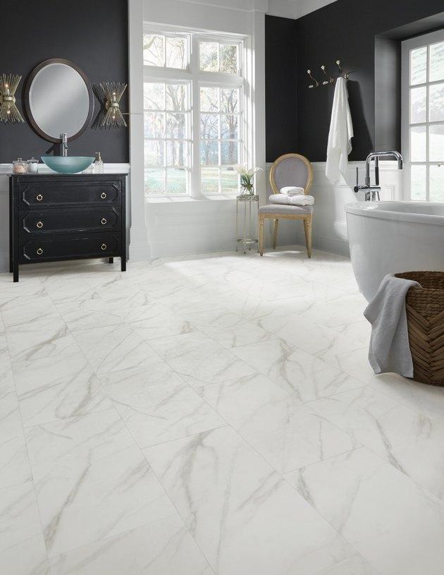 Bathroom with marble-like flooring.