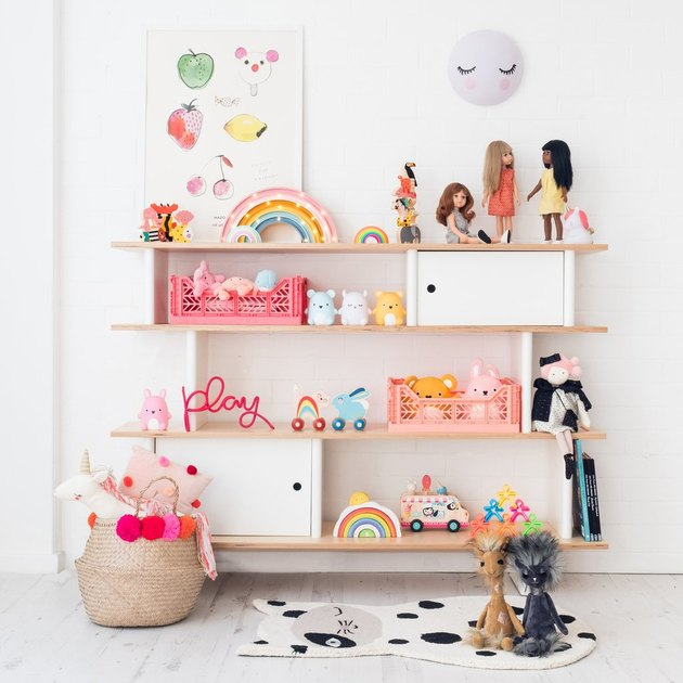 minimalist toy storage idea with bookcase filled with toys