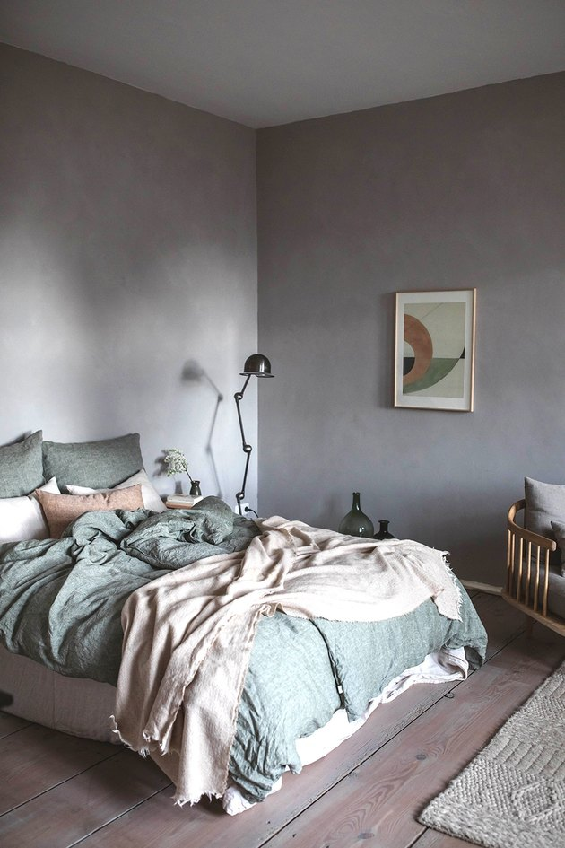 Lavender minimalist room paint colors in bedroom with green linen bedding