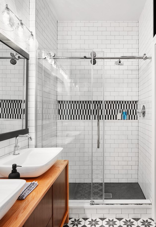 black and white bathroom with shelf shower storage ideas