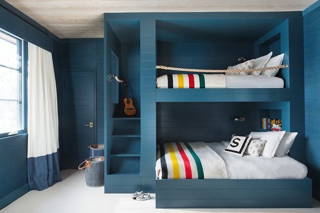 minimalist with color in blue room with bunkbeds