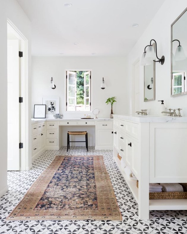 bathroom rug idea in white bathroom and patterned floor tile