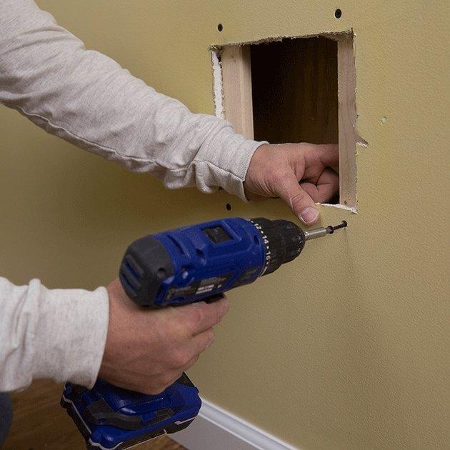 Backer strips in drywall hole.