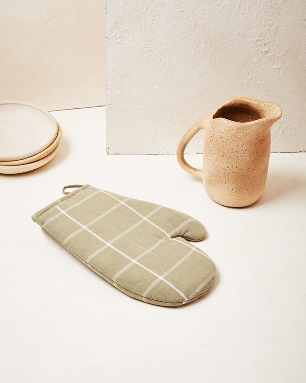 checkered oven mitt in light green color with pitcher nearby