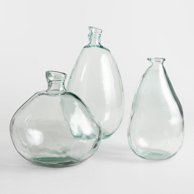 Set of three large bulbous clear vases in different sizes with small mouths