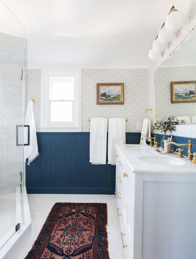 bathroom rug idea with blue vertical tongue and groove wall paneling
