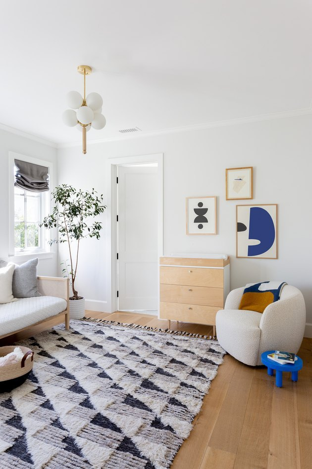 minimalist with color in white room with rug and lounge chair