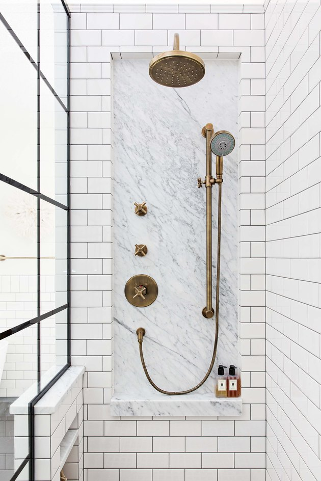 shower storage ideas with marble inlay and brass shower head